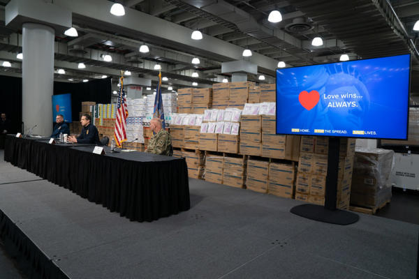 Andrew Cuomo with supplies during COVID